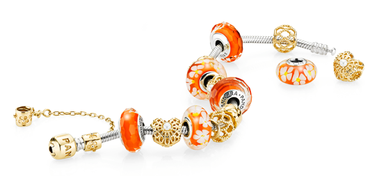 Pandora bracelet with orange murano charms and 14k gold charms