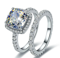 Cushion halo diamond engagement ring and wedding band